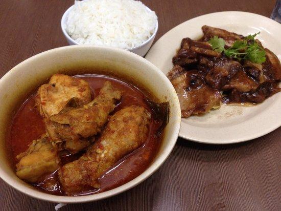Nancy's Kitchen Restaurant : Chicken with candlenut curry and pork with tamarind sauce