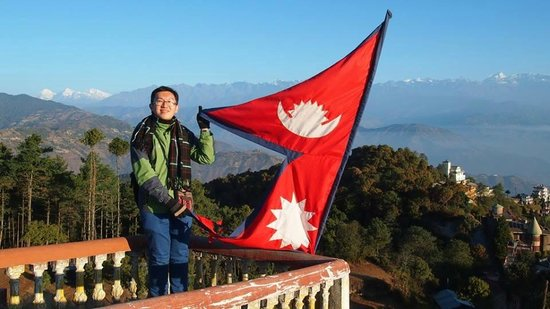 Waving the Nepal flag at Nagarkot - Picture of Blue Mountain