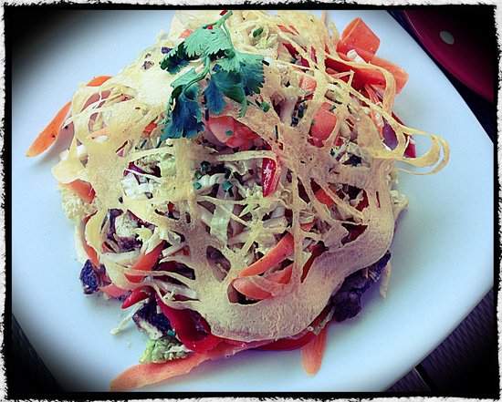 The Runaway Spoon: Asian chicken coleslaw salad topped with an eggs nest. skim photo