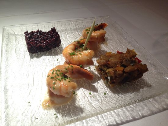 Sautéed shrimp and scallops in a butter ginger sauce with black rice ...
