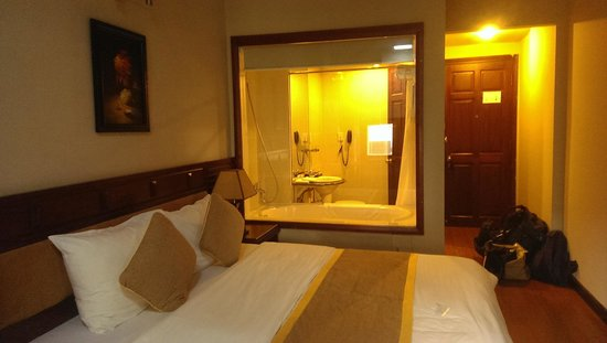 Asia Hotel: bedroom and bathroom