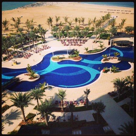Waldorf Astoria Ras Al Khaimah: The family pool seen from our balcony