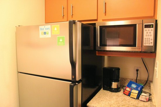 HYATT house Austin / Arboretum: Kitchen with full sized fridge and microwave