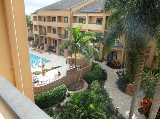 Courtyard West Palm Beach: View of the pool from our third floor balcony