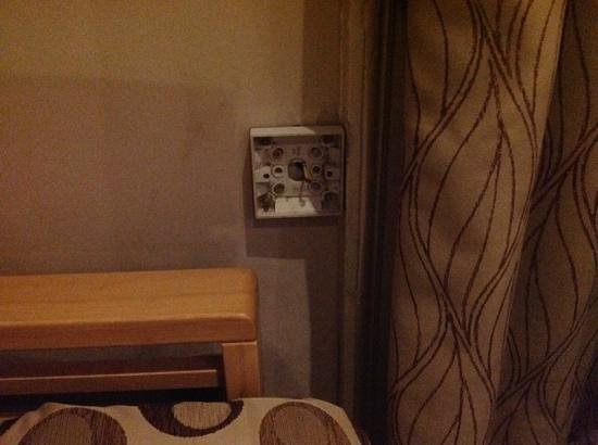The Royal Oak at Keswick: exposed plug socket, glad my kids weren't in this FAMILY room