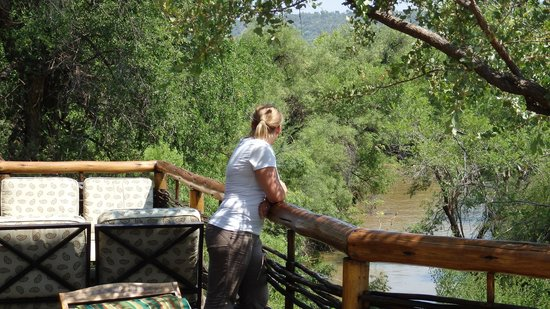 Thakadu River Camp: enjoying the view from sun deck (elephants playing in the river)