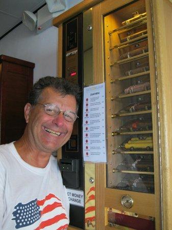 Taste of Belgium Restaurant: Unusual Cigar Dispenser and Unusual Face