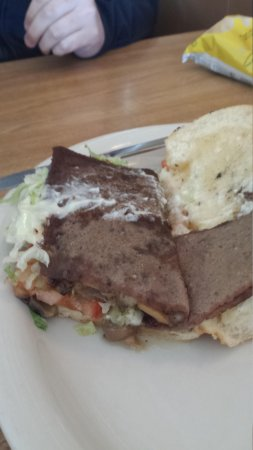 Angelo's Restaurant & Raw Bar: Steak & Cheese? Looks more like a slab or gritty processed meat.