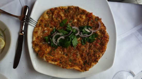 A La Turka: Lahmacun with onions, parsley flakes and lemon juice