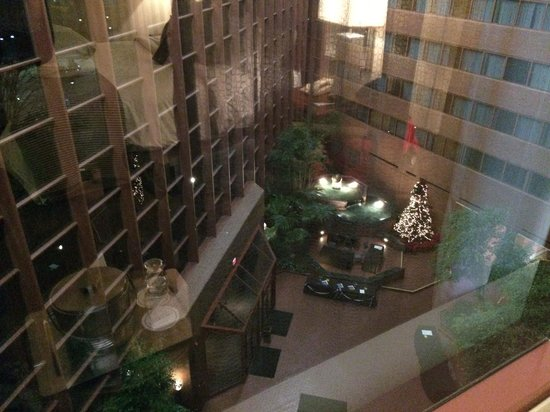 Omni Charlottesville : View of atrium from room - Christmas/holiday decorations and setting up for First Night