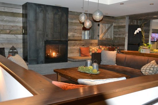 Teton Mountain Lodge & Spa- A Noble House Resort: Fireplace seating area near Spur and storage room for skiing equipment