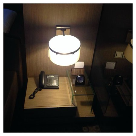 Hotel H2O: Bed side table. I just wish there is an outlet near table
