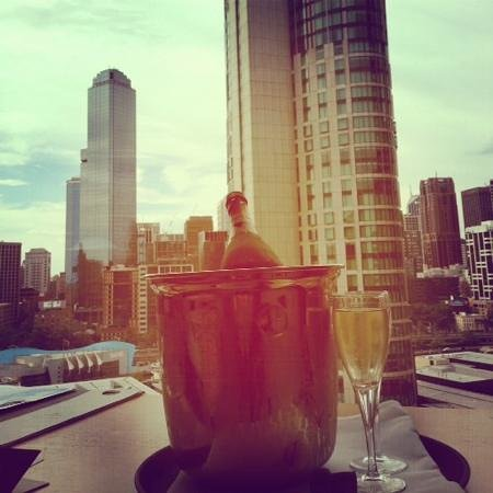Crown Promenade Melbourne: A glass of sparkling while enjoying the view from my corner room.