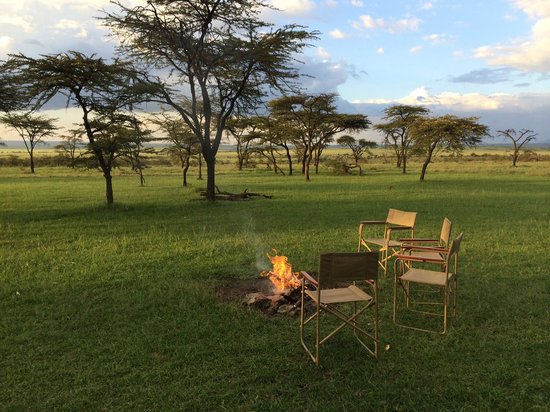Mara Bush Houses, Asilia Africa: The campfire we sit around for sunset and before dinner, overlooking the plains of the Mara