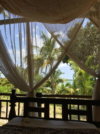 Pole Pole Bungalows: View from the Zanzibari bed on the porch of the bungalows - could lie here all day!
