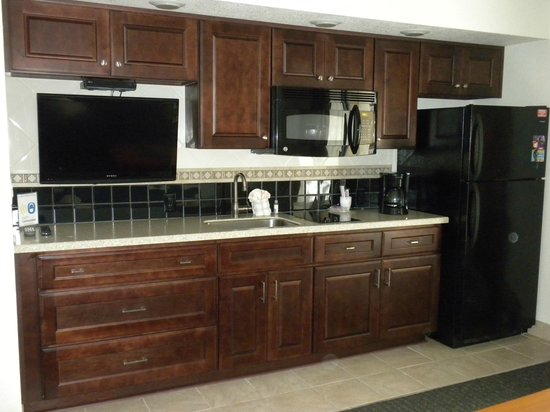 Beach Cove Resort : 713 Kitchen area with wall TV and full sized refrigerator