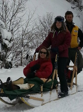 Absaroka Dogsled Treks: Guide Nate with Guests on tandem sled