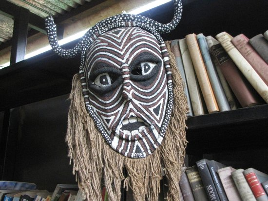 Livingstone Backpackers : A mask next to the office area.