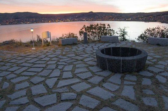 Libertador Lake Titicaca: Hotel grounds, lights of Puno across water