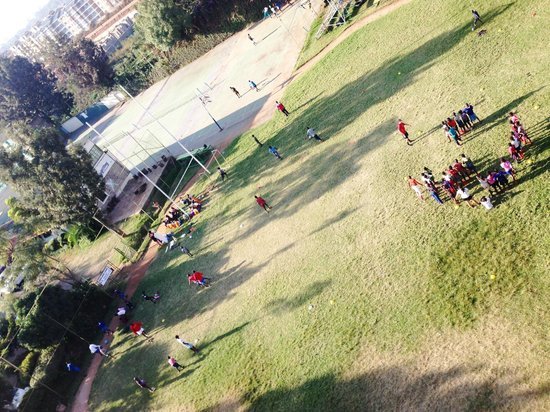 Sadili Oval B & B: An afternoon view of people partaking in activities on the weekend. Beautiful open field.