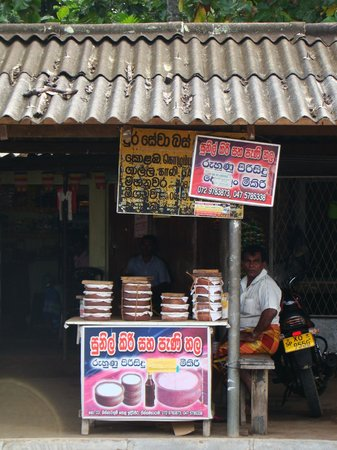 Road side stalls that sell curd and honey.