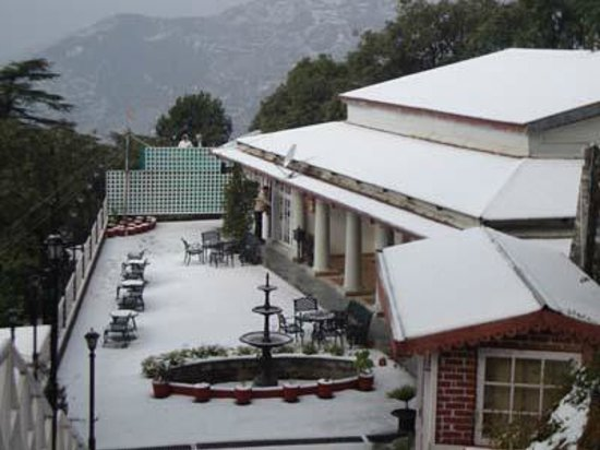 Karma Vilas Resort: The front lawn with rooms facing the expanse of the Doon Valley