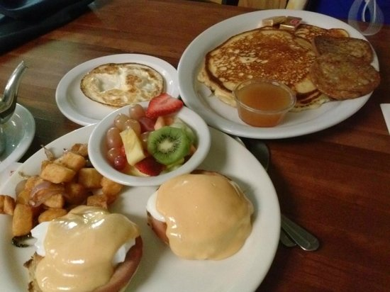Makai Cafe : classic eggs benedict with home fries, banana pancakes with house syrup!