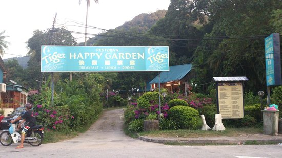 Happy Garden: The garden entrance with the restaurant roof visible