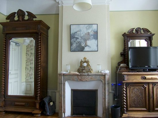 Hotel Diderot: Huge armoire and antique fireplace