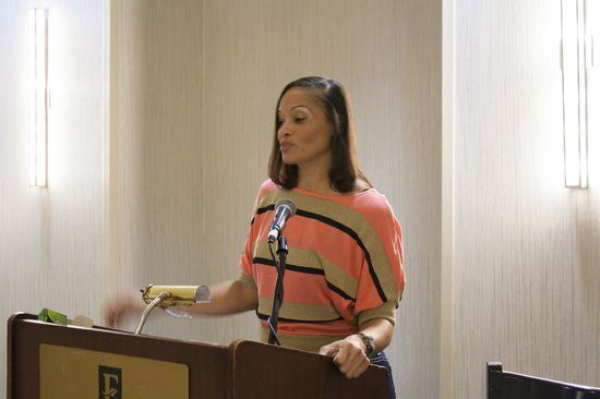 Embassy Suites by Hilton Orlando Downtown: Ahsha Marie Baby Shower - grandma gray at podium