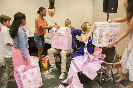 Embassy Suites by Hilton Orlando Downtown: Ahsha Marie Baby Shower - opening gifts