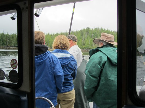 Bella Misty Fishing Charters: Fishermen watching as another one is reeled in.
