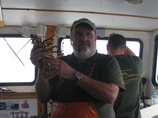 Lulu Lobster Boat: Captain with a lobster