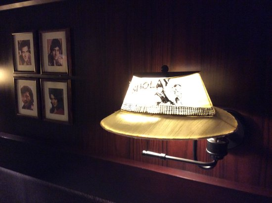 The Silver Tips: Lamp shade above the bed designed as Dharmendra's hat in SHOLAY
