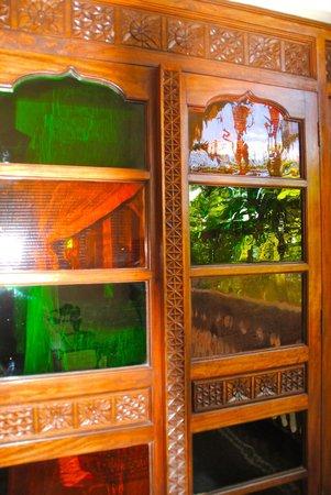 Zanzibar Serena Hotel: stained glass from balcony looking into master bedroom