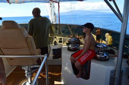 Hula Girl Excursions: my son sitting at the captains area