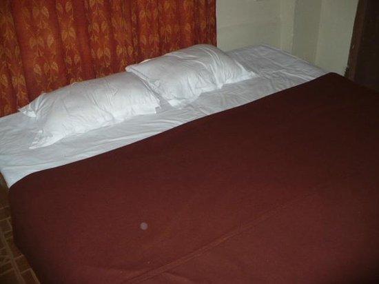 Tranquillity Beach Resort : bed