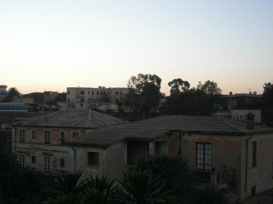 Sunshine Hotel: View over gardens of quaint, though fading, Italian colonial architecture nearby