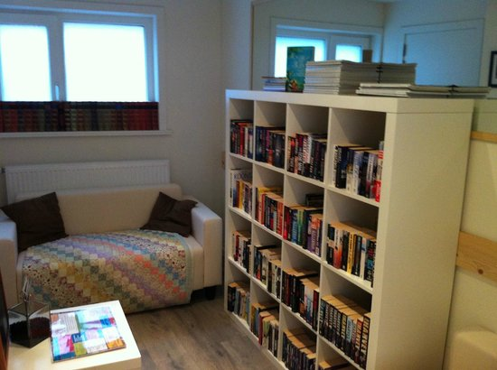 Books & Brunch: Comfy seating area & books upstairs