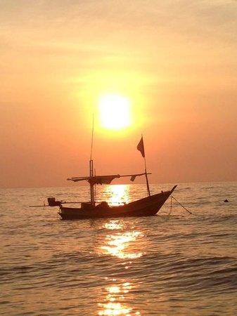 Devasom Hua Hin Resort: A thai fishing boat floating on the waves