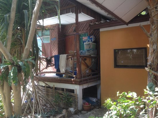 Kirati Beach Resort : This was the bungalow next to us!! Rubbish and empty boxes al aver the balcony.