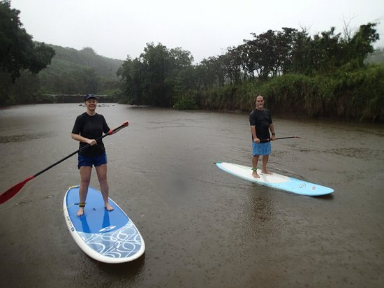 Boarding House Surfboard Rentals: Paddle boarding on a river in Oahu