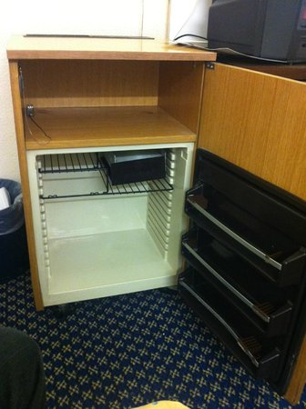 "The County Hotel: 1970's ""minibar"" empty and switched off."