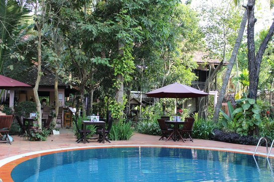 The River Garden Siem Reap: Pool with poolside bar looking towards rooms in lush gardens.