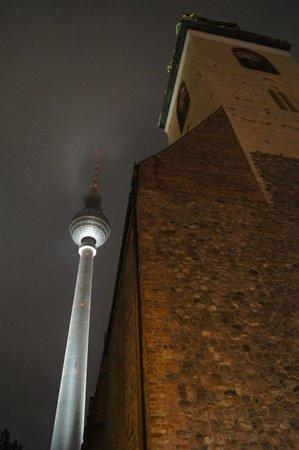 Television Tower : Телебашня в низких облаках на фоне кирхи.