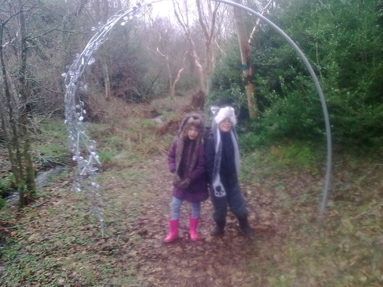 Sculpture of heron picture of stone lane gardens chagford stone lane gardens 2 grandkids under the arch tallulah and leon workwithnaturefo