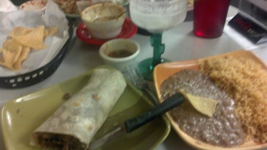 Lily's Mexican Restaurant: Carne asada burrito, beans and rice, chips, queso dip (almost all gone!), frozen margarita