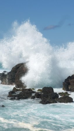 Paia, HI: Waves crashing over the lava rock