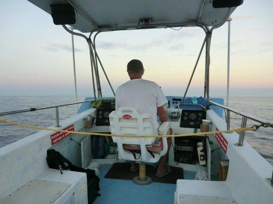 Captain Dan McSweeney's Whale Watching Adventures: Dan McSweeney driving the boat