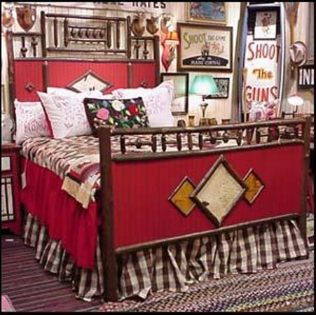 Timpson Creek Gallery carries Steve Trainor furniture like this red bed